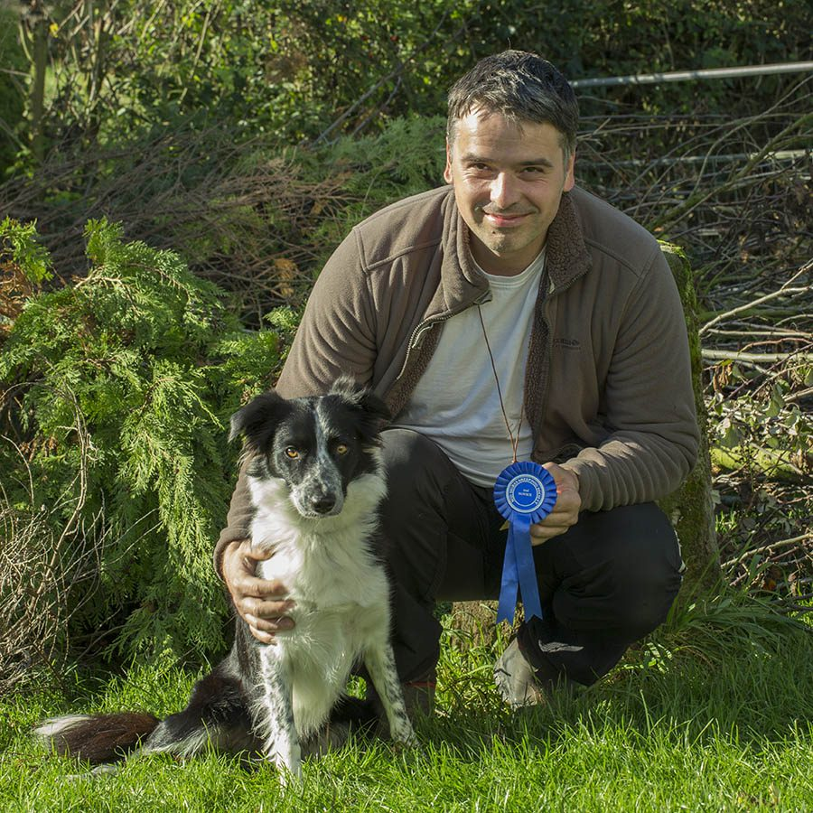 Photo of Slawek with Kay who didn't want to work sheep but then went on to win a sheepdog trial